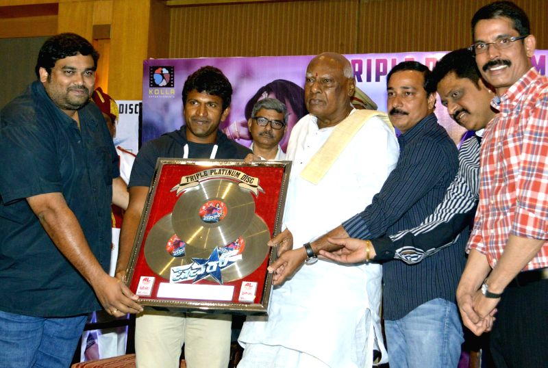 Acting Governor of Karnataka K Rosaiah with Tulsiram Naidu,popularly known as Lahari Velu actor Puneet Rajkumar and others during CD release of 'Power Star'  in Bangalore on July 10, 2014. - Puneet Rajkumar and Tulsiram Naidu