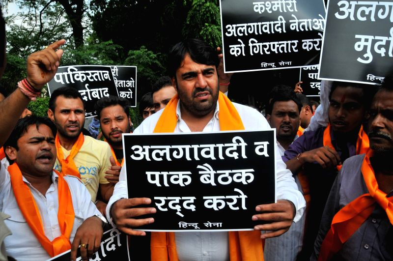 Activist of Hindu Sena demonstrate against meeting of separatist leaders from Jammu and Kashmir and Pakistani envoy at Pakistan High Commission, in New Delhi on Aug 18, 2014.