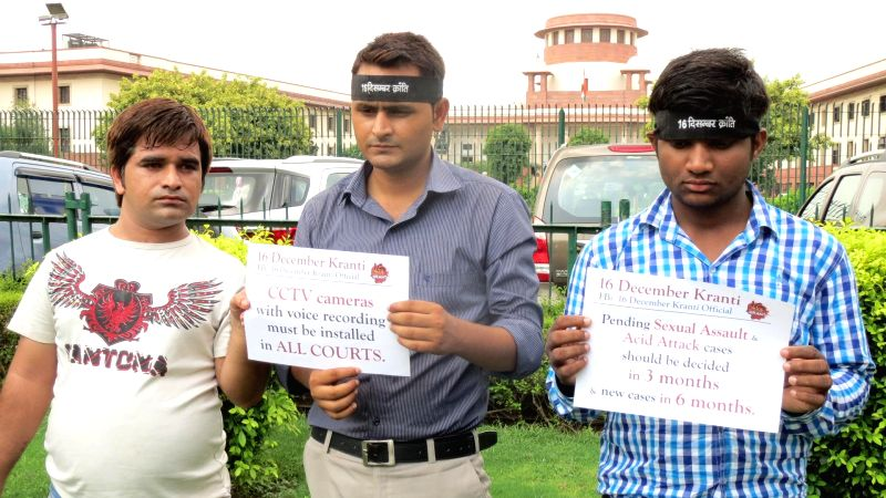 Activists demonstrate against Supreme Court's stay on the death sentence awarded to two of the four men in the December 16 gang-rape and murder case in New Delhi on July 16, 2014.