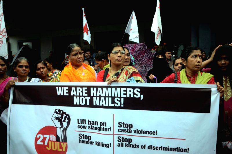 Activists of AIDWA, DYFI and SFI staga a demonstration to press for their various demands in Mumbai on July 27, 2016.
