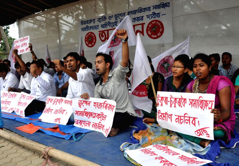 Activists of All Assam Student's Union (AASU) stage a sit-in demonstration in Guwahati on July 31, 2014.