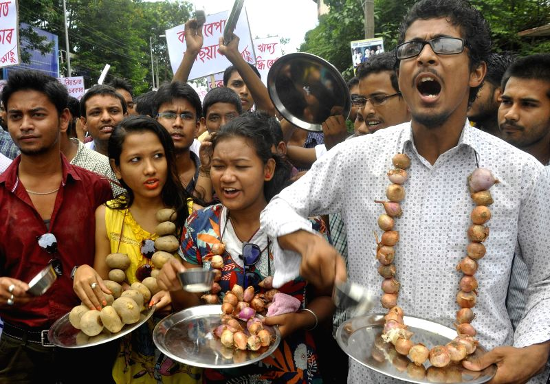 Activists of All Assam Students Union (AASU) demonstrate against hike in prices of essential commodities in Guwahati on July 19, 2014.