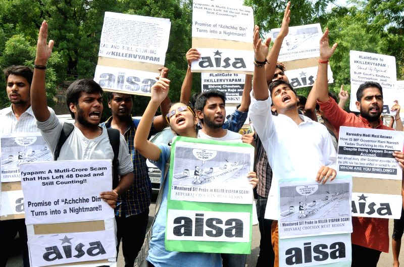 Activists of  All India Students Association (AISA) shout slogans during a demonstration to protest against Madhya Pradesh Chief Minister Shivraj Singh Chauhan over Vyapam Scam at Jantar ... - Shivraj Singh Chauhan
