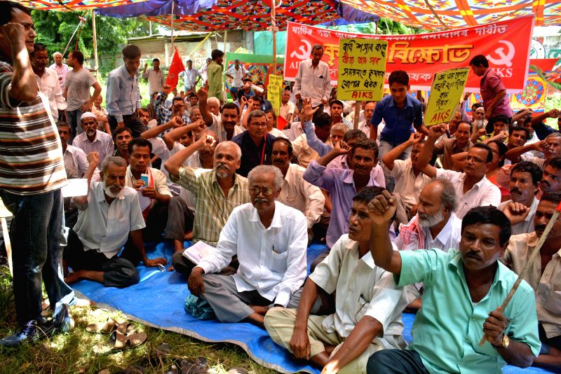 Activists of Asom Raijik Krishak Sabha (ARKS) stage a demonstration to press for their demands in Guwahati on Aug 11, 2014.
