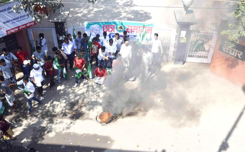 Activists of Chhatra Samagam, the JD (U) students' wing demonstrate in front of BSNL office in Patna on Aug 29, 2014.