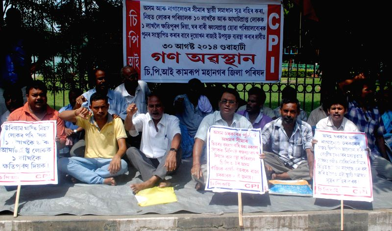 Activists of Communist Party of India (CPI) sit in protest demanding to solve the Assam-Nagaland border issue and rehabilitation to the family's suffered during Naga miscreants attack on Assam ...