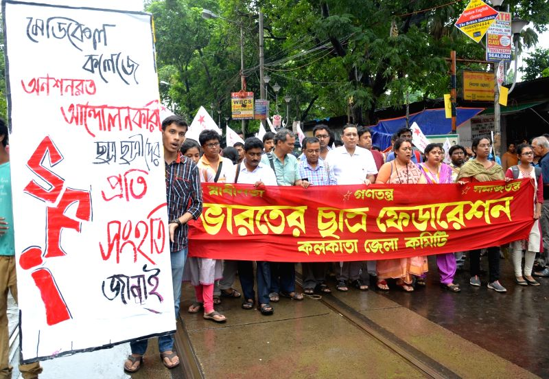 Activists of CPI-M's student wing Students' Federation of India (SFI) stage a demonstration to show their solidarity for Kolkata's medical students on hunger strike on July 22, 2018.
