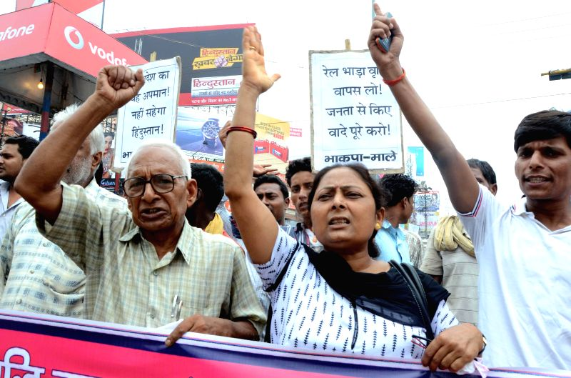 Activists of CPI (ML) demonstrate against Prime Minister Narendra Modi`s Central Government during price hike to Rail in Patna on June 21, 2014. - Narendra Modi
