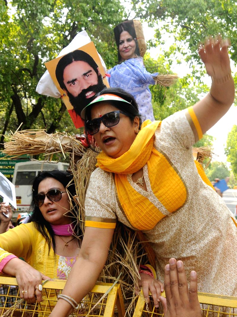 Activists of Delhi Mahila Congress demonstrate against Yoga guru Ramdev in New Delhi on May 1, 2014.