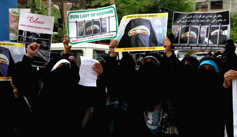 Activists of Dukhatran-e-Millat (DeM) stage a demonstration to press for release of DeM chief Asiya Andrabi and her close aide Fahmeeda Sofi in Srinagar, on May 16, 2017.