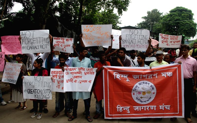 """Activists of Hindu Jagran Manch stage a demonstration after West Bengal Assembly on Thursday passed a resolution renaming the state as """"Bangla"""", in Kolkata on July 28, 2018."""