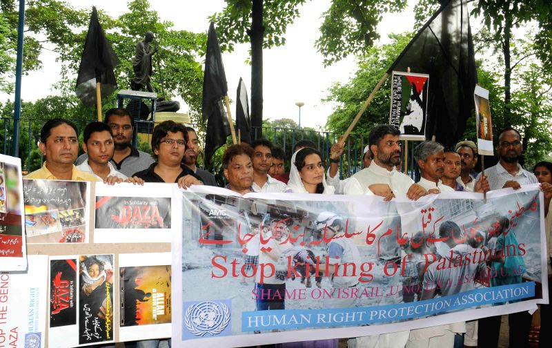 Activists of Human Right Protection Association demonstrate against Israeli attacks on Gaza in Kolkata on July 15, 2014.