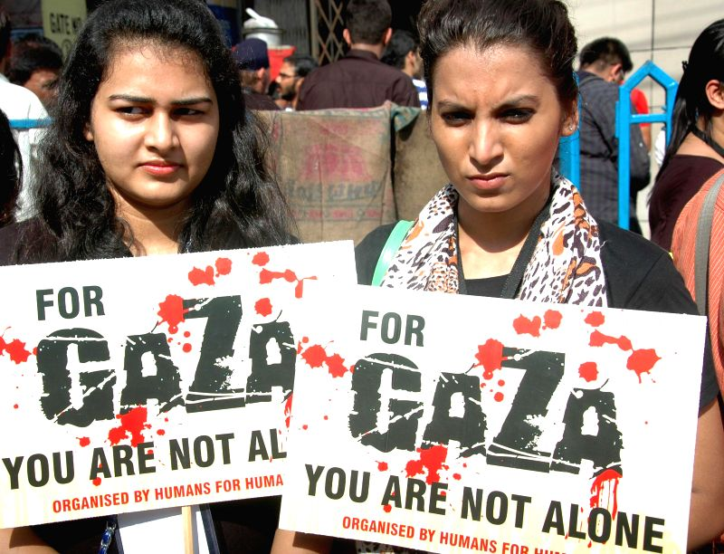 Activists of Humans for Humanity organisation during a rally protesting against Israel actions in Gaza in Kolkata on July 26, 2014.