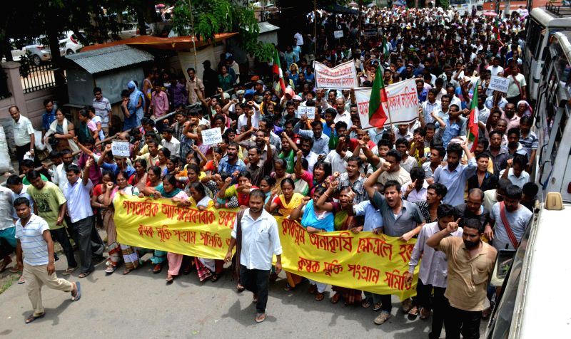 Activists of Krishak Mukti Sangram Samiti (KMMS) led by its chief Akhil Gogoi stage a demonstration in Guwahati on July 31, 2014.