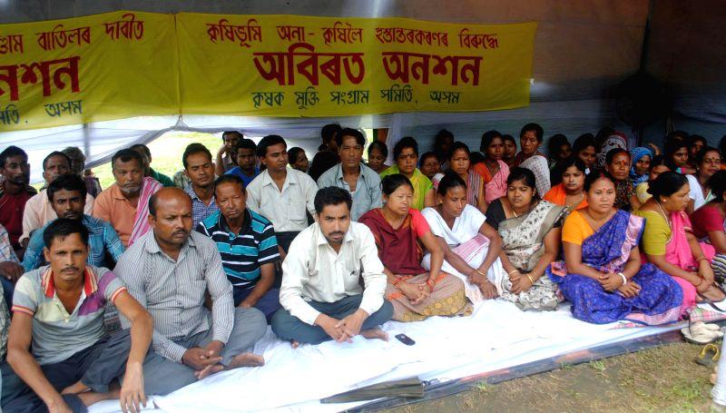 Activists of Krishak Mukti Sangram Samittee, staging on indefinite hunger strike (4days) at Dighalipuhuri par, against the handing over farmers land to unassamese businessman in Guwahati on July 24, .