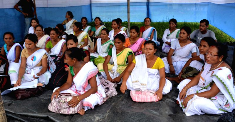 Activists of Moran Jatiya Mahila Parishad stage a demonstration to press for their demands in Guwahati on Aug 4, 2014.