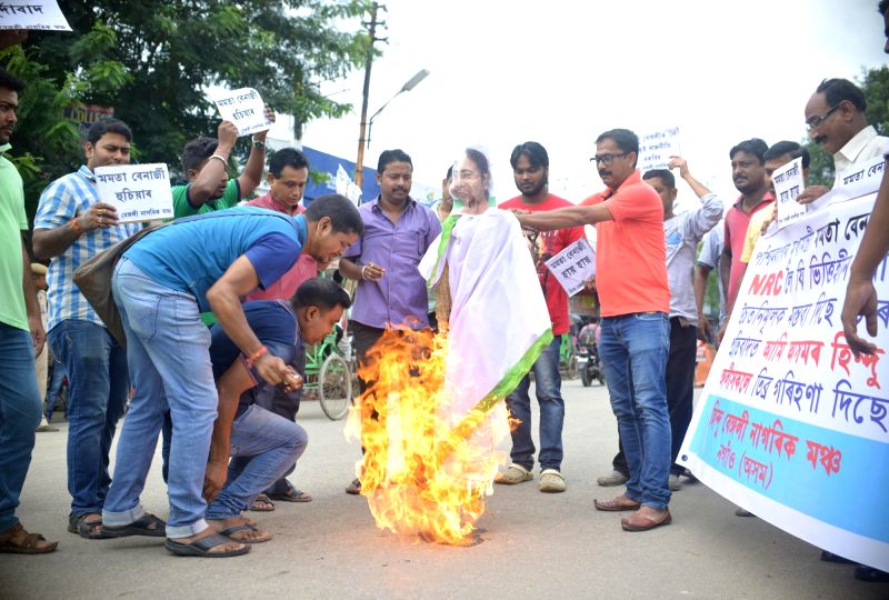Activists of Nagarik Mancha burn the effigy of West Bengal Chief Minister Mamata Banerjee as they stage a demonstration against her comments on the outcome of the final draft list of the ... - Mamata Banerjee
