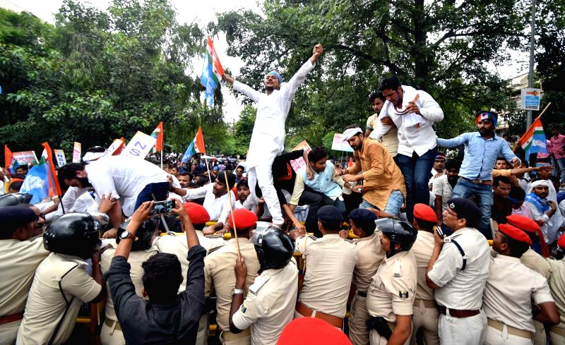 Activists of National Students' Union of India (NSUI) stage a demonstration to press for their various demands, in Patna on July 30, 2018.