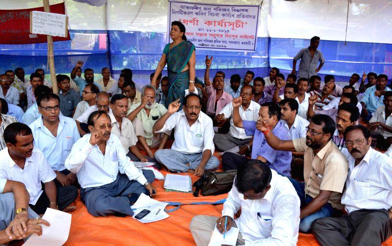 Activists of Sadou Asom Inland Water Transport Shramik Sangha (SAIWTSS) demonstrate to press for their demands in Guwahati on Aug 11, 2014.