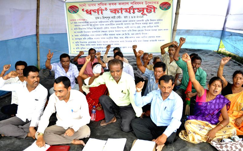 Activists of Sadou Asom Shramik-Krishak Kalyan Parishad (SASKKP) stage a demonstration to press for their demands in Guwahati on Aug 6, 2014.