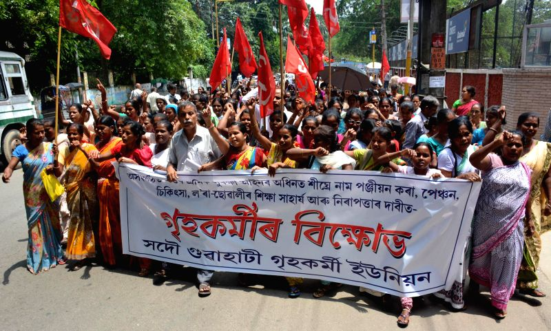 Activists of Sadou Guwahati Home workers Union (SGHWU) under the aegis of CITU demonstrate to press for their demands in Guwahati on Aug 20, 2014.