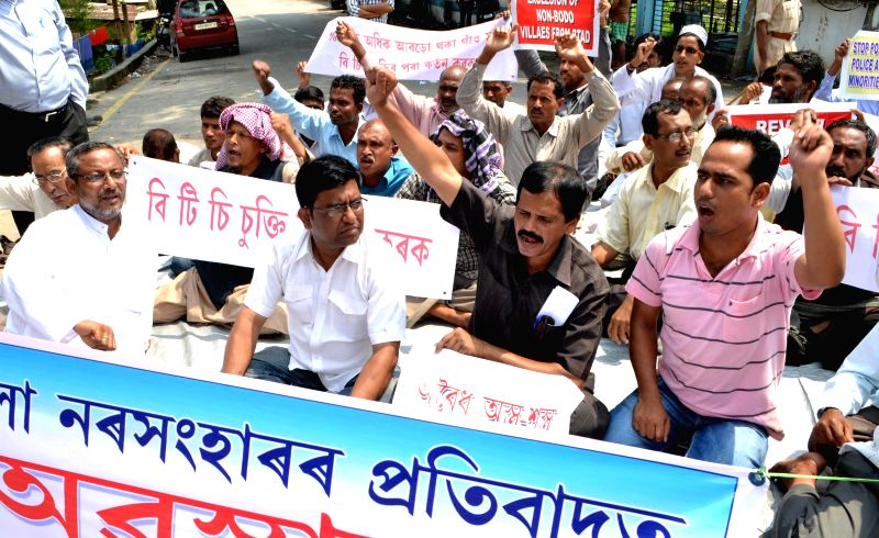 Activists of Sanmilito Janagosthiyo Sangram Samity stage a demonstration against recent violence in Bodoland Territorial Area Districts (BTAD) of Assam, in Guwahati on May 9, 2014.