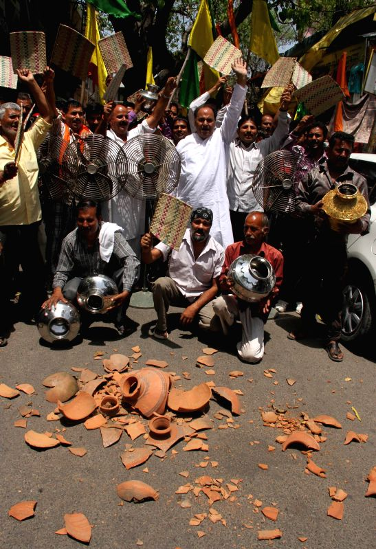 Activists of Shiv Sena and Dogra Front protesting against water and electricity crises in Jammu on May 10, 2014.