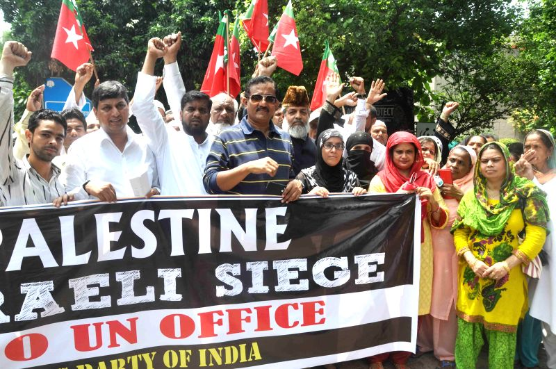 Activists of Social Democratic Party of India stage a demonstration to protest against Israeli attack on Gaza outside United Nations office in Lodhi Road of New Delhi on Aug 18, 2014.
