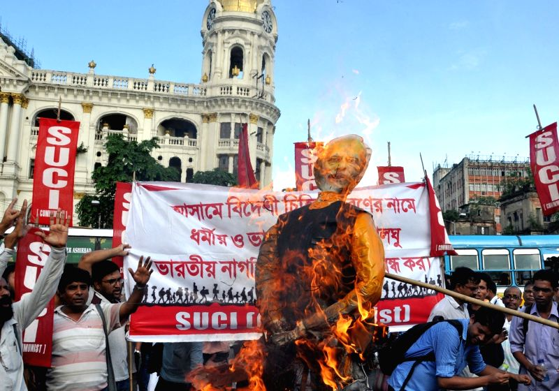 Activists of Socialist Unity Centre of India-Communist (SUCI-C) stage a demonstration against NRC in Assam, in Kolkata on Aug 8, 2018.