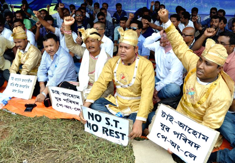 Activists of Tai-Ahom Yuba Parishad (TAYP) stage a demonstration to press for their demands in Guwahati on Aug 6, 2014.