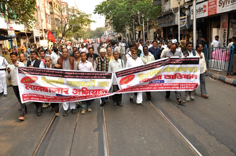Activists of taxi union participate in a rally, 'Lalbazar Abhijan' in Kolkata on Jan. 28, 2015.