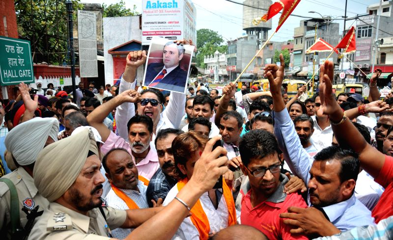 Activists of various Hindu organizations stage a demonstration at Hall Gate in Amritsar to vent out their anger against torching of langar tents setup for devotees at Baltal in Jammu and Kashmir, on .