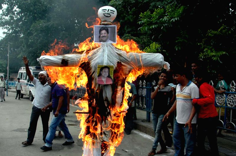 Activists of Women's Resistance Committee burn an effigy of Krishnanagar MP and Trinamool Congress leader Tapas Paul who was caught on a video threatening to gun down his Marxist rivals and ...