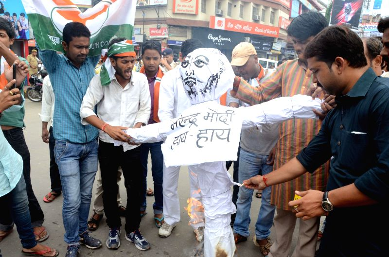 Activists of Youth Congress burns an effigy of Prime Minister Narendra Modi as they shout anti-government slogans during a protest against the hike in rail fares in Patna on June 21, 2014. - Narendra Modi