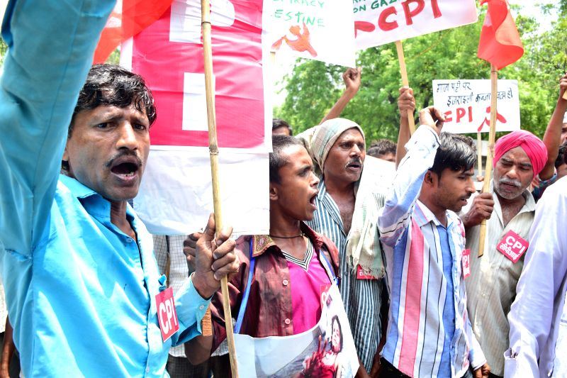 Activists under Palestine Solidarity Committee participate in a rally to protest against Israeli attacks on Gaza in New Delhi on July 17, 2014.