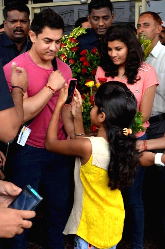 Actor Aamir Khan being greeted by a young fan on his arrival at the airport in Jodhpur.