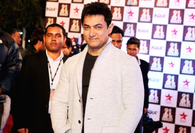 Actor Aamir Khan during Aap Ki Adalat's 21st anniversary celebrations in New Delhi on Dec 2, 2014. - Aamir Khan