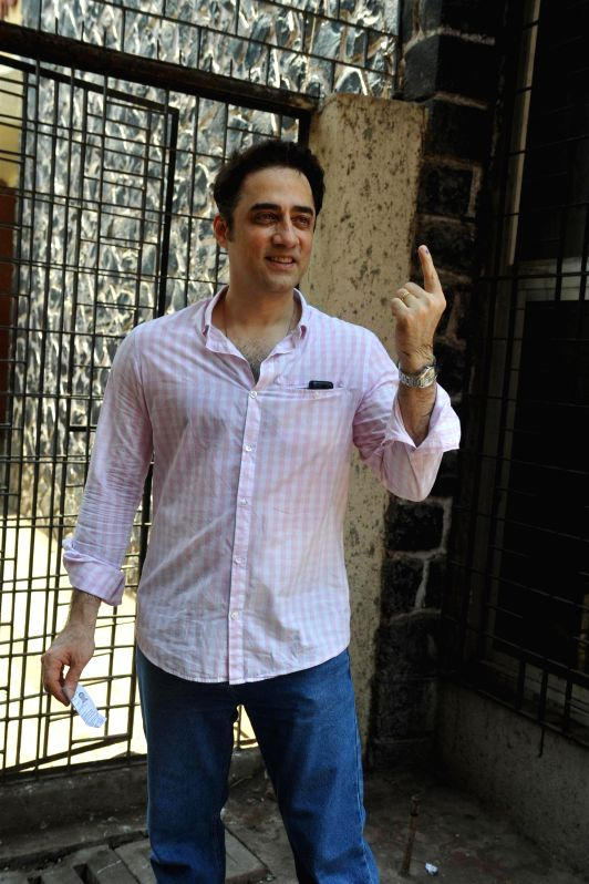 Actor Aamir Khan's brother Faisal Khan after casting his vote for the Lok Sabha elections, in Mumbai, on April 24, 2014. - Aamir Khan