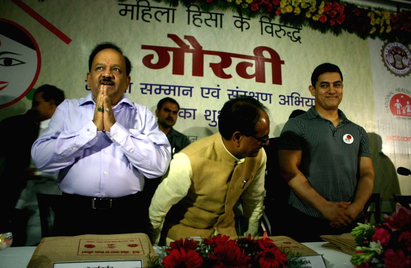 Actor Aamir Khan with Madhya Pradesh Chief Minister Shivraj Singh Chouhan and Union Minister of Health and Family Welfare Dr Harsh Vardhan during a pragramme on ``violence on women`` in Bhopal on ... - Shivraj Singh Chouhan