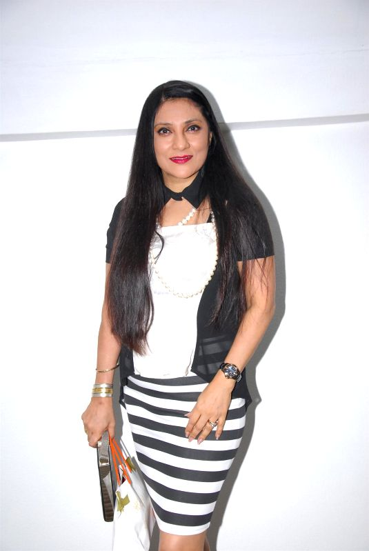 Actor Aarti Surendranath during the birthday celebration of artist Rouble Nagi in Mumbai on July 7, 2014. - Aarti Surendranath