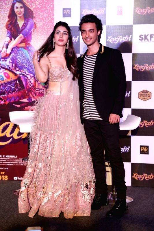 """Actor Aayush Sharma and  actress Warina Hussain  at the promotion of film LoveRatri in New Delhi on Aug. 6, 2018. Salman Khan is launching his brother-in-law Aayush Sharma with """"Love ... - Aayush Sharma and Salman Khan"""
