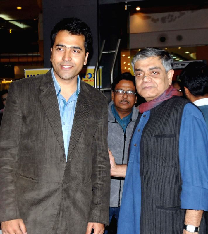 Actor Abir Chatterjee with filmmaker Sandip Roy during the premiere of Bengali film `Badshahi Angti` in Kolkata, on Dec 19, 2014. - Abir Chatterjee and Sandip Roy
