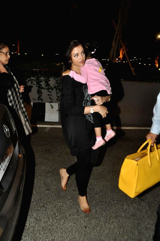 Actor Aishwarya Rai Bachchan with daughter Aaradhya snapped leaving for Cannes Film Festival 2014 at Mumbai International Airport on Thursday, May 15, 2014.