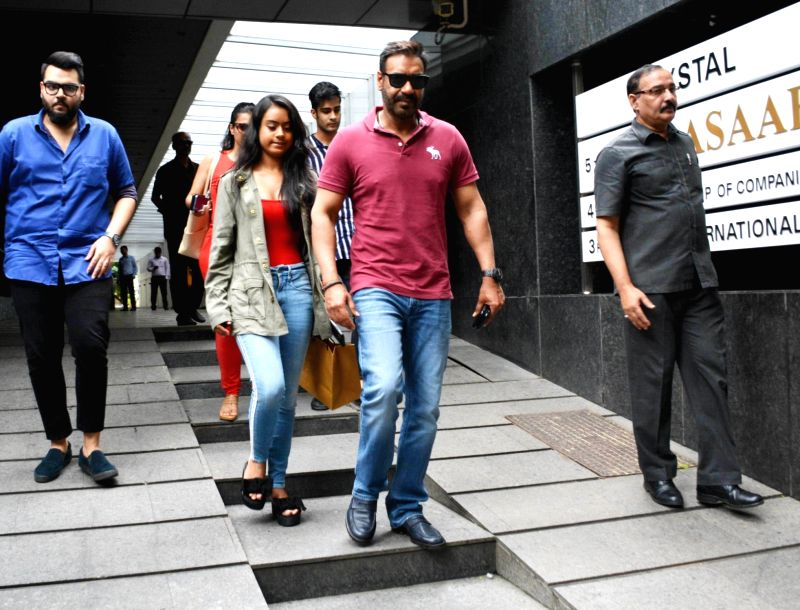 Actor Ajay Devgn along with his daughter Nysa Devgn seen at a restaurant in Bandra, Mumbai on Aug 7, 2018. - Ajay Devgn