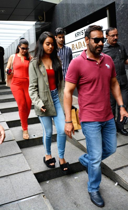 Actor Ajay Devgn along with his wife Kajol and daughter Nysa Devgn seen at a restaurant in Bandra, Mumbai on Aug 7, 2018. - Ajay Devgn and Kajol