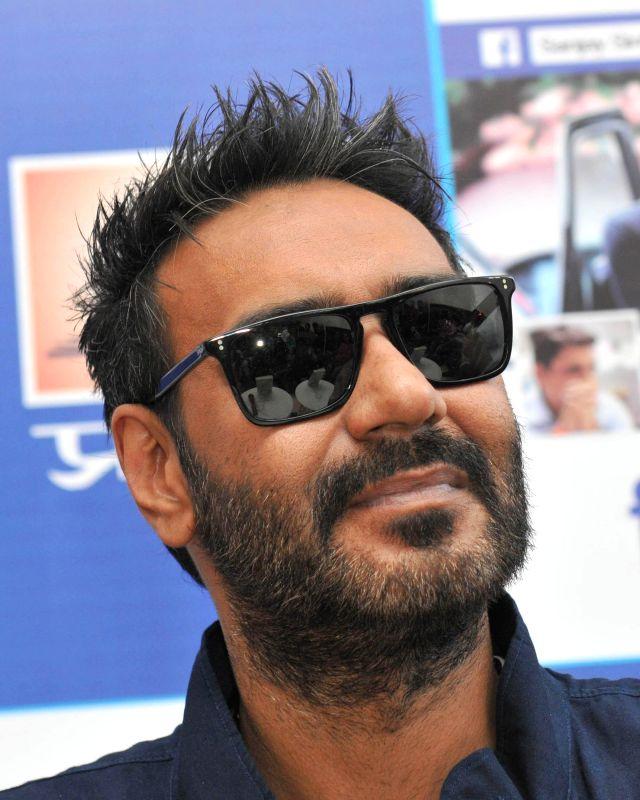 Actor Ajay Devgn at the launch of Sanjay Sinha's book `Rishtey` in New Delhi, on Dec 3, 2014.
