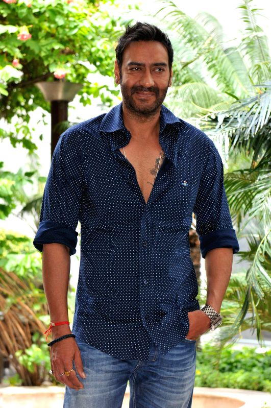 Actor Ajay Devgn during a photo shoot organised to promote his upcoming film `Drishyam`  in New Delhi, on July 28, 2015. - Ajay Devgn