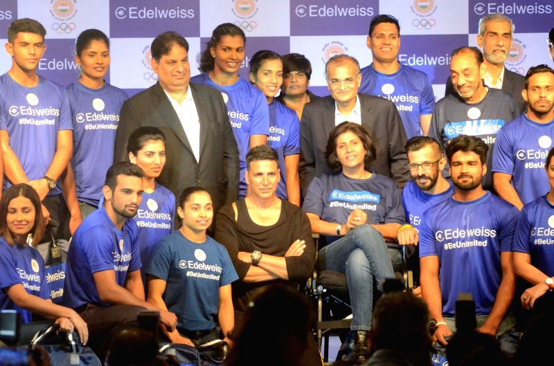 Actor Akshay Kumar and para-athlete Deepa Malik with the athletes who will be representing India in the upcoming 18th Asian Games during a programme organised to extend best wishes to them, ... - Akshay Kumar and Malik
