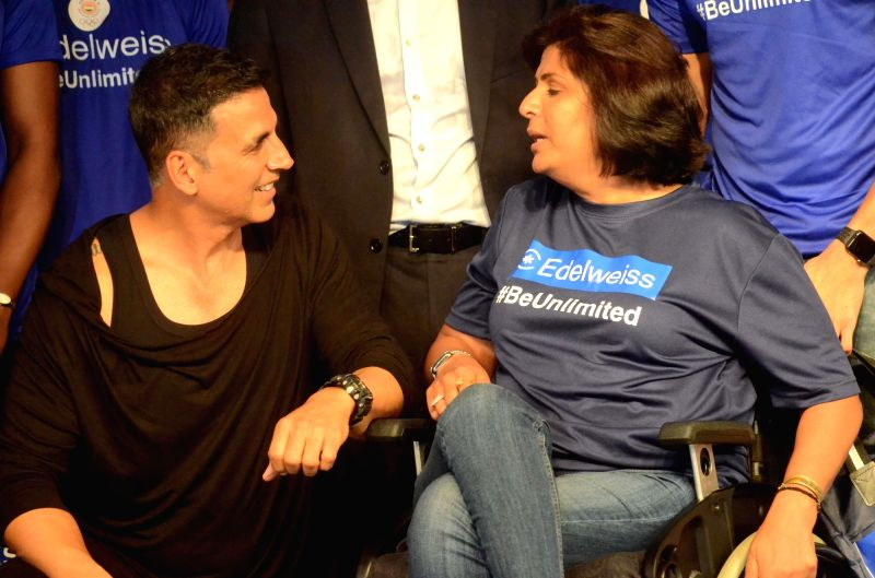 Actor Akshay Kumar in a conversation with para-athlete Deepa Malik during a programme organised to extend best wishes to the athletes who will be representing India in the upcoming 18th Asian ... - Akshay Kumar and Malik