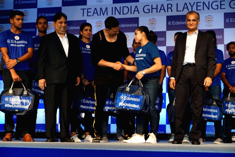 Actor Akshay Kumar interacts with Indian gymnast Dipa Karmakar during an event to wish good luck to Indian athletes for the 2018 Asian Games, in Mumbai on July 28, 2018. - Akshay Kumar